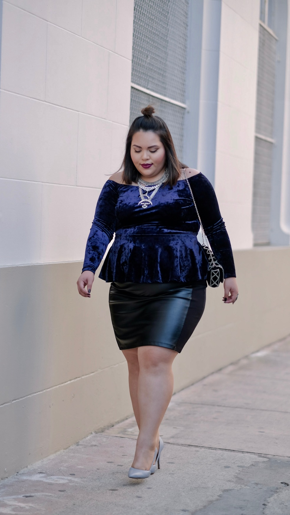 Let's Talk Chic Fashion Blogger Drea Wearing a Plus Size Crushed Velvet Off the Shoulder Peplum Top and Faux Leather Black Pencil Skirt