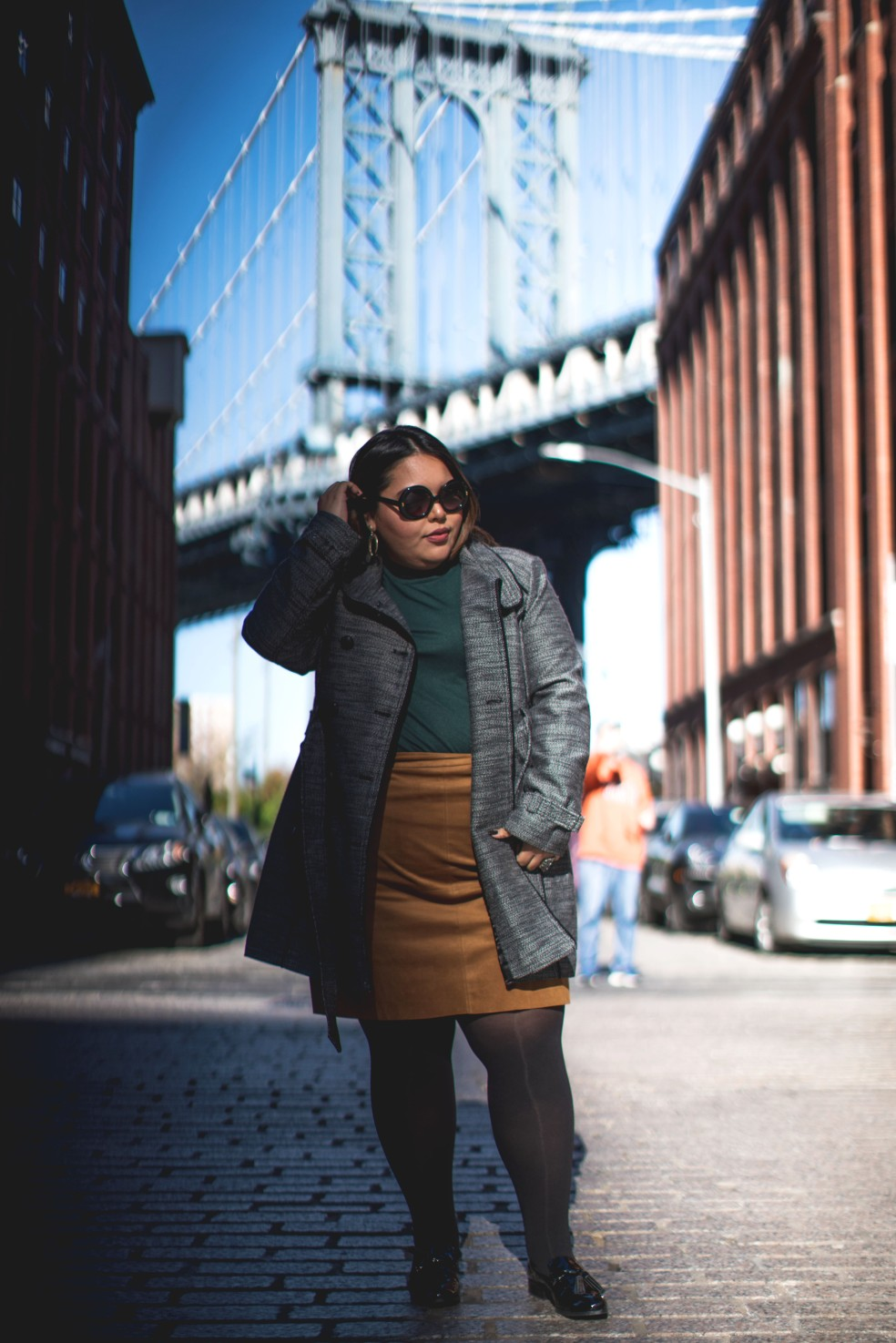 Let's Talk Chic plus size blogger wears a double-breasted walker coat, faux suede skirt, and Marc Fisher loafers