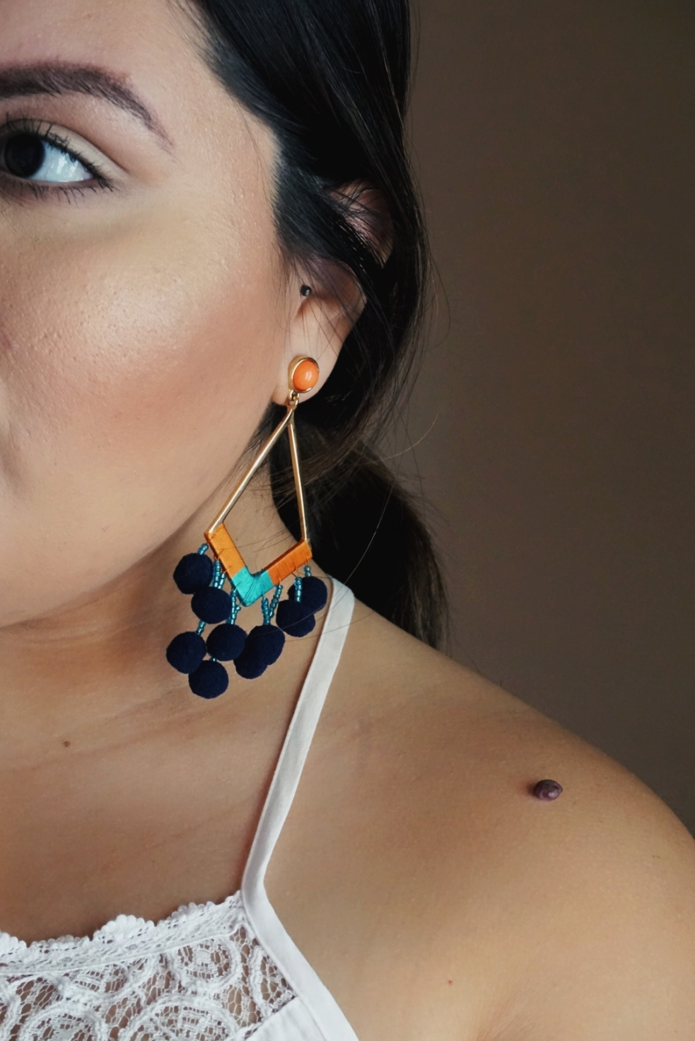Styling Statement Pom Pom Earrings for Spring